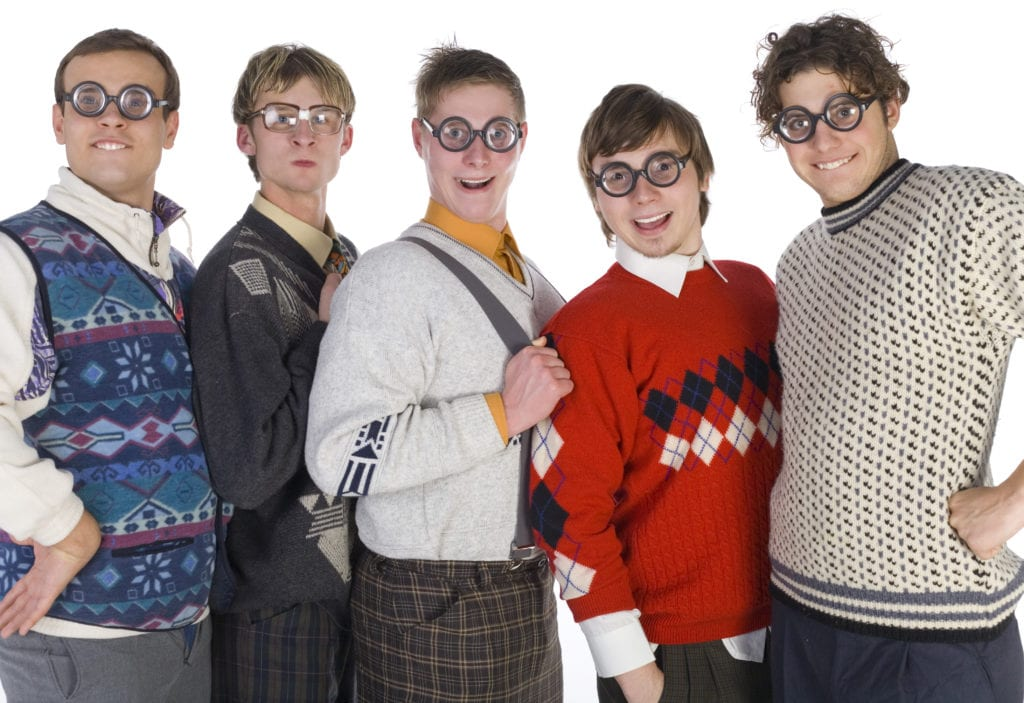 """Group of white men dressed in stereotypical """"nerd"""" clothing"""
